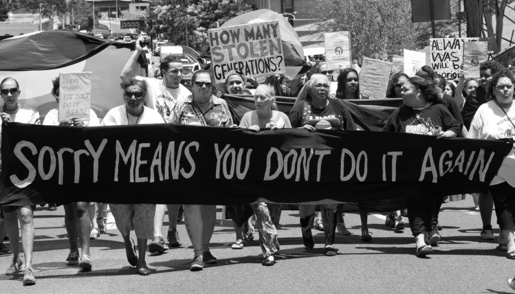 Photo taken of a protest march in 2014. Original image on www.stopstolengenerations.com.au