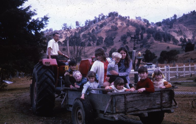 Children in the back of a tractor driven wagon